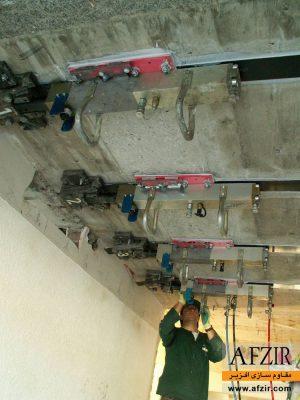 افزایش ظرفیت باربری در ساختمان بتنی با اعمال پیش تنیدگی به لمینیت FRP